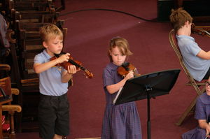 Boy and Girl on Violin Year 2 Music Concert