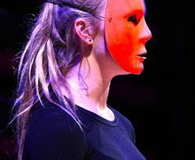 Girl with Mask Acting in Fourth Form Play After Juliet