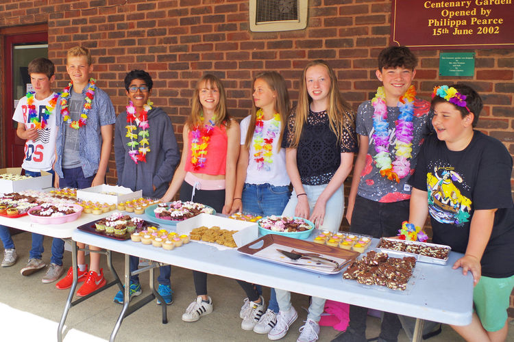 Pupils selling cakes at prefects charity day