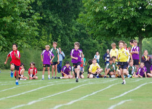 Boys racing at prep school sports day