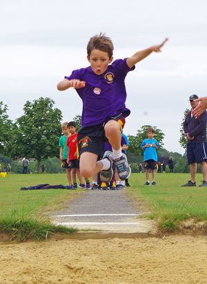 Boy highjumping on shell sports day