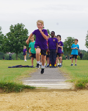 Boy in high jump at shell sports day