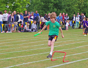 Boy in race at shell sports day