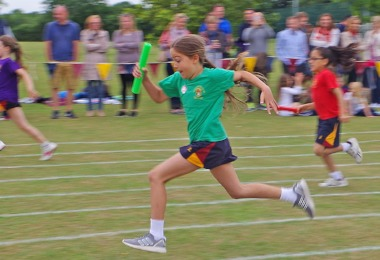 Girl racing on shell sports day