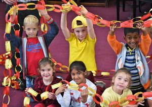 Pre-Prep holding chain on Whole College Charity Day