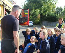 Listening to the fireman at Year 1 fire station visit