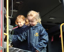 Year 1 girls in fire truck at fire station visit