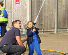 Spraying water at Year 1 fire station visit 2017