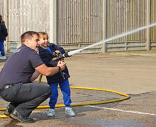 Year 1 girl with hose at Fire Station 2017