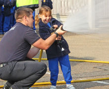 Year 1 with hose at Fire Station Oct 2017