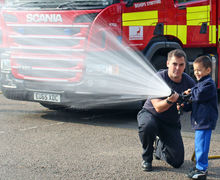 Year 1 Boy spraying water at Fire Station 2017