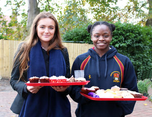 Alinah benson house with cakes for charity week