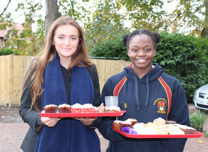 Benson girls with tray of cakes for charity week