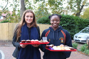 Alinah & Benson House Sixth Former with Charity Week cakes