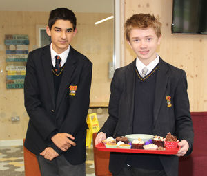 Sutton house boys with cakes for charity week