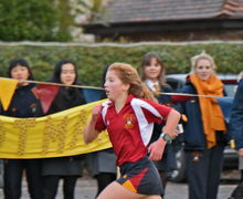 Benson House girl running with audience Pearl Cup 2017