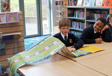 Form 2 Boy looking at Curiosity Club book