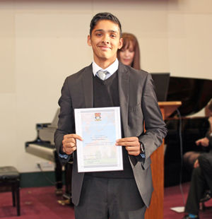 Sutton House Diversity Ambassador Receiving Certificate