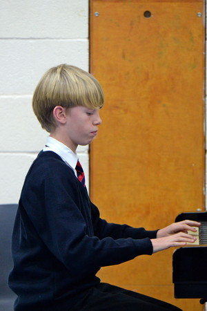 Prep School Boy playing piano