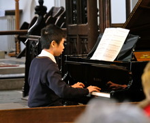 Justin playing piano in St Michael