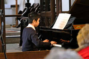 Justin playing piano in St Michael's Church