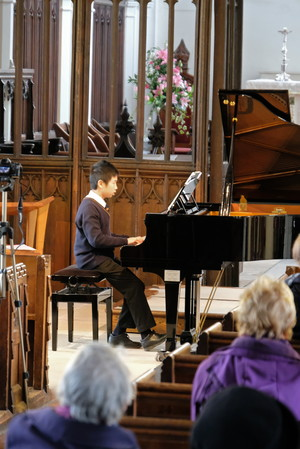 Justin performing in St Michael's Church