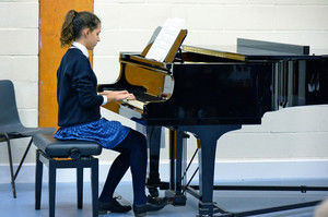 Prep School girl playing piano