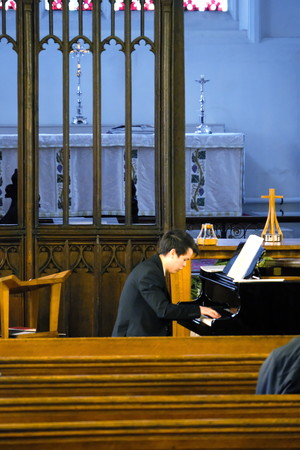 Scott on piano in St Michael's Church