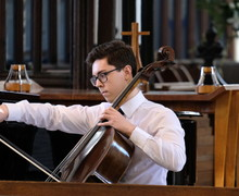 Chris performs on cello in St Michael
