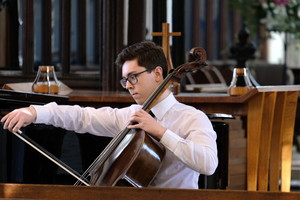 Chris performs on cello in St Michael's Church