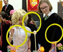 Sixth Former with pupil for Harry Potter event