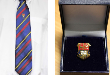 Tie and badge