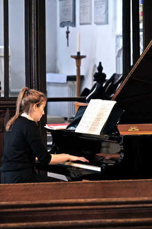 Ailsa playing the piano in St Michael's Church Recital