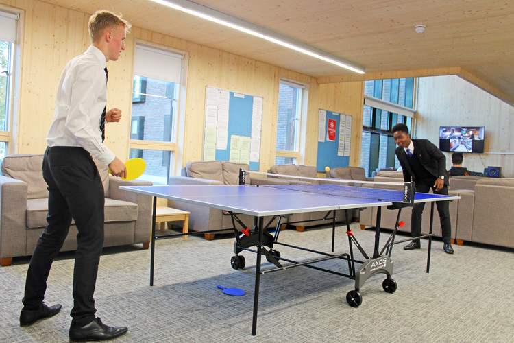 Boys playing table tennis in Rowe House