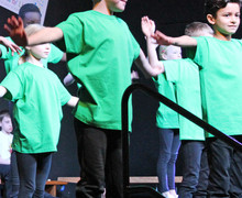 Shell play dancers with green teeshirts