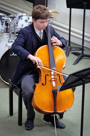 Boy on cello in 4th Form Concert