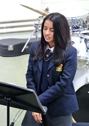 Girl singing in 4th Form Concert