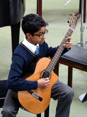 4th Form Concert Boy playing guitar