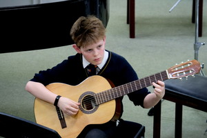4th Form Concert Boy on Guitar