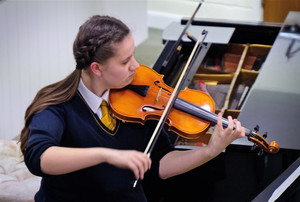 Billianna playing violin in 4th Form Concert