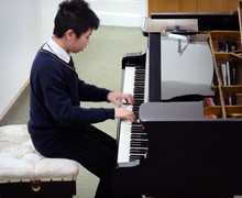 Justin playing in 4th Form Recital