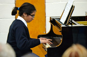 girl pianist in prep school music