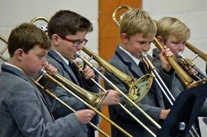 Boys playing trombones in a Prep School concert
