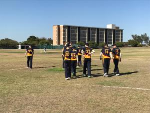 Senior School cricketers on pitch in S Africa