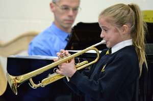 Prep school girl playing musical instrument