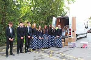 Benson and Sutton House students loading van for BVI