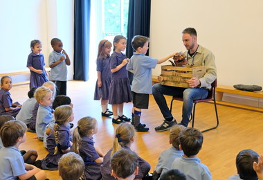Reception pupils meet dinosaur puppet
