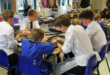 Yr 1 boys with L6 helpers in clay ant art workshop