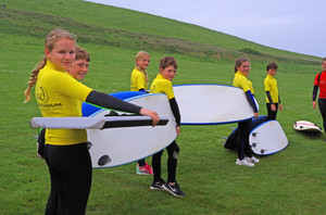 F2 carrying surf boards on Science Trip to Cornwall