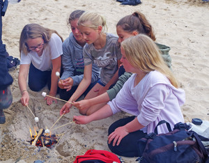 F2 enjoying marshmallows on the beach in Cornwall